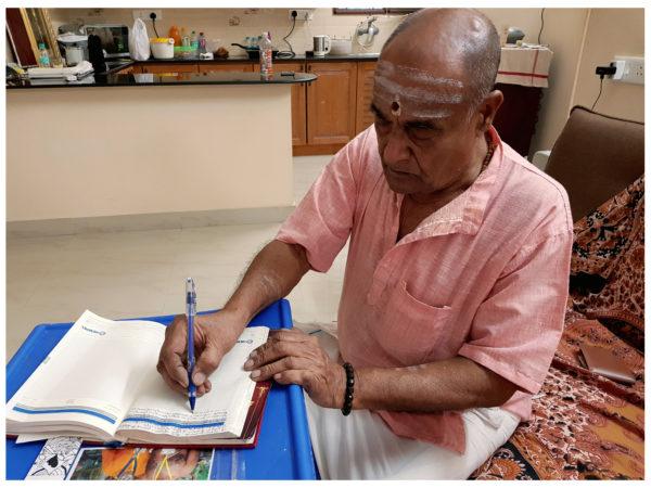 Yegnarama Narayanan writing in his current notebook