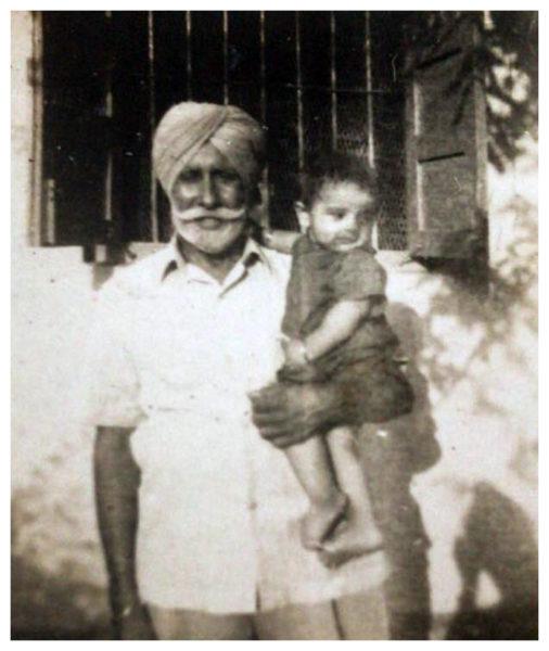 Sepoy Amar Singh holding his grandchild